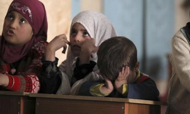 Children attend a lesson conducted by activists in a mosque after schools were closed in Aleppo.