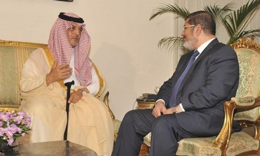 Egypt's President Mohamed Morsi (R) meets with Saudi Arabia's Foreign Minister Prince Saud al-Faisal