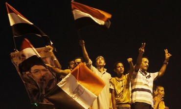 Muslim Brotherhood members brace for new government, plan protests.