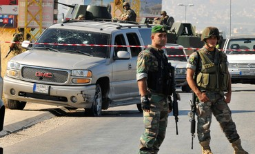 Lebanese soldiers at site of roadside bomb near the Lebanese-Syrian border July 16, 2013.