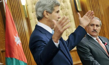 Jordan's Foreign Minister Nasser Judeh with Kerry speak in Amman July 17, 2013.