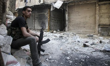 A Free Syrian Army fighter in Yarmouk refugee camp
