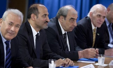 President of Syrian Opposition Coalition Ahmed Asi Al-Jerba (2nd L), along with members of the SOC.