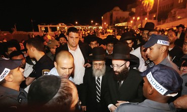POLICE ESCORT newly elected Sephardi Chief Rabbi Yitzhak Yosef to the Western Wall.