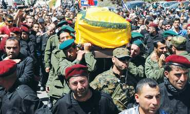 Hezbollah Supporters carry the coffin of a group member during his funeral in the Bekaa Valley.