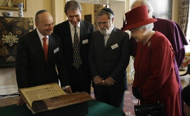Britain's Queen Elizabeth is shown the Codex Valmadonna I book by Jewish guests