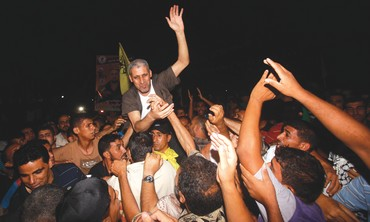 FREED PRISONER Atiya Salem Moussa returns to a hero's welcome in the Gaza Strip on Tuesday.