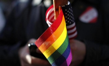 Gay pride and American flags.