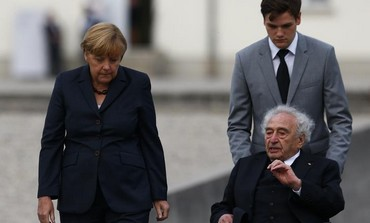 German Chancellor Angela Merkel speaks with Max Mannheimer, a Holocaust survivor, at Dachau.