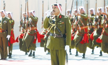 JORDAN'S BEDUIN honor guard stands at attention at Amman's international airport.
