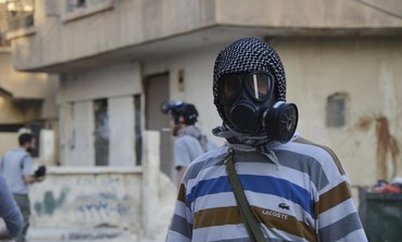 A Syrian activist wearing a gas mask where chemical weapons were allegedly used near Damascus.