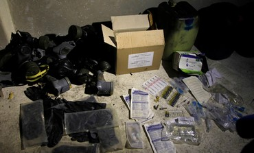 Chemical materials and gas masks are pictured in a warehouse at the front line of clashes in Syria.