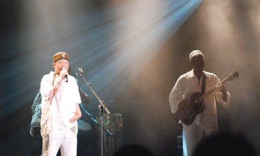 SALIF KEITA (left) performing at the Womad Festival at Charlton Park in England.