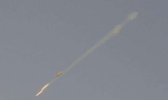 A Syrian Air Force fighter plane fires a rocket during an air strike