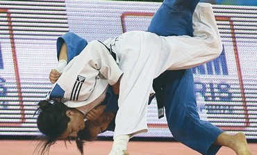 YARDEN GERBI (in white) had a stunning gold-medal victory for Israel yesterday at the judo Worlds.