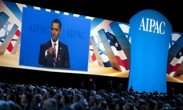 US President Obama pictured on-screen speaking at AIPAC policy conference in Washington, March, 2012