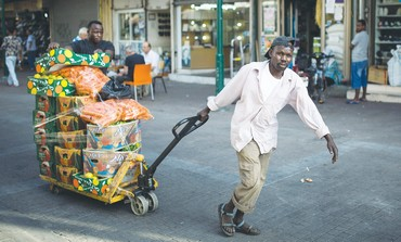 African migrants transport vegetables in south Tel Aviv