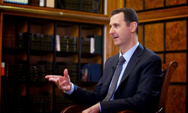 Syria's President Bashar Assad speaks during an interview September 12, 2013.