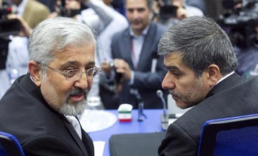 Iran's Head of Atomic Energy Organization Fereydoon Abbasi-Davani (R) and ambassador to IAEA