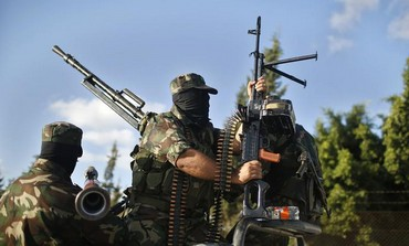 Hamas militants take part in a protest against peace talks between Israel and the Palestinians.
