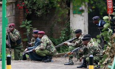 Kenyan police officers take position in the capital Nairobi, September 23, 2013.