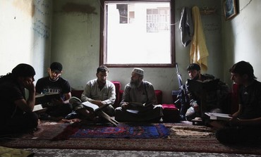 Free Syrian Army members take Islam lessons in Aleppo's Saif al-Dawla district, September 18, 2013.