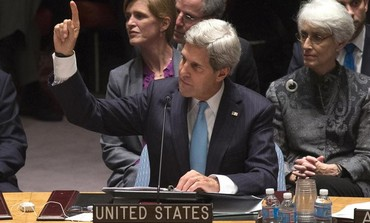 Kerry votes with the other members of the United Nations Security Council on September 27, 2013.