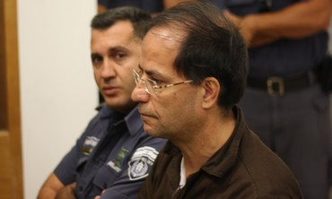 Suspected Iranian spy Ali Mansouri attends a remand hearing in a Petah Tikva court, Sept. 30, 2013.