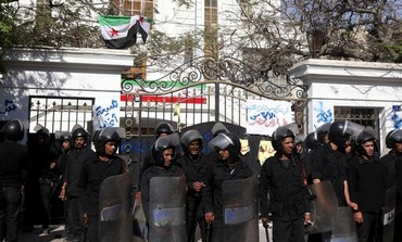 Police stand guard outside the Iranian ambassador's house during a protest against Iran in Cairo.