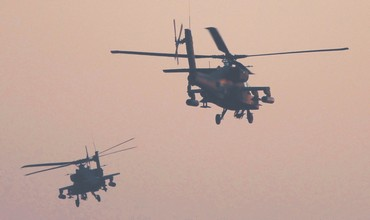 Egyptian Apache helicopters fly over Tahrir Square in Cairo