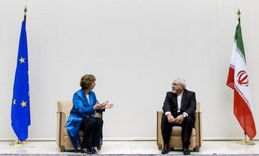European Union foreign policy chief Catherine Ashton (L) speaks with Iranian Foreign Minister