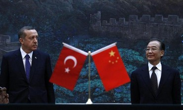 Turkey's Prime Minister Recep Tayyip Erdogan (L) and Chinese Premier Wen Jiabao.
