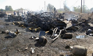 Debris from suicide bombing in Hama, Syria, October 20, 2013.