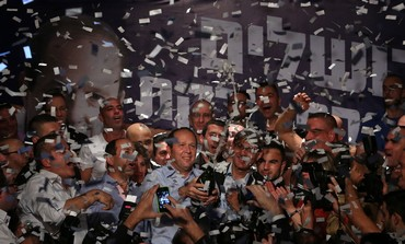 Incumbent Jerusalem Mayor Nir Barkat celebrate his victory in municipal election, October 23, 2013.