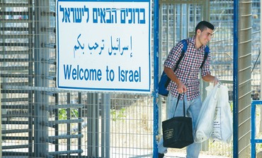 A Druse student studying in Syria crosses into Israel at the Quneitra border crossing.