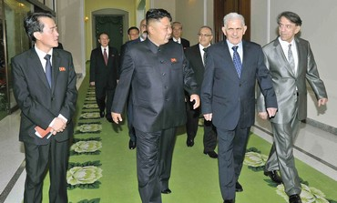 NORTH KOREAN leader Kim Jong-Un walks with Syria's Abdullah al-Ahmar.