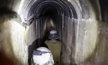 IDF soldiers walking down tunnel built by Hamas for terrorism.