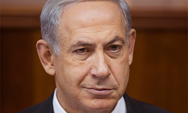 Binyamin Netanyahu attends the weekly cabinet meeting in Jerusalem, November 3, 2013.