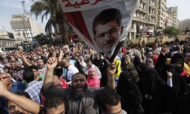Supporters of ousted Egyptian president Mohamed Morsi outside the Egyptian High Court in Cairo.