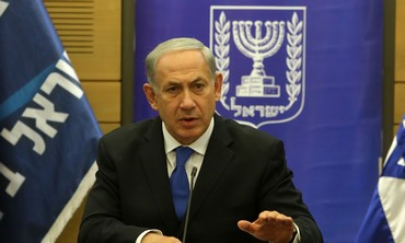 PM Binyamin Netanyahu speaks to reporters at the start of the Likud faction meeting in the Knesset.