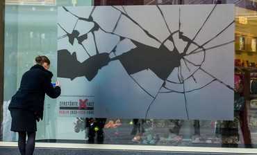 A sticker simulating broken glass on a shop window in Berlin to mark 'Kristallnacht' anniversary