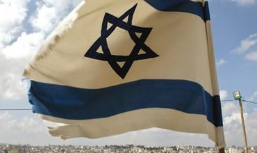AN ISRAELI flag flutters near Psagot in the West Bank.