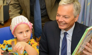 Belgium's foreign minister Didier Reynders with patient.