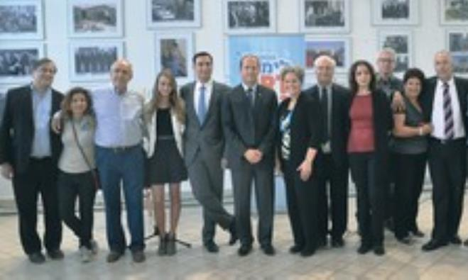 Nir Barkat is flanked by members of the Peres and Begin families at Limmud FSU event in Jerusalem