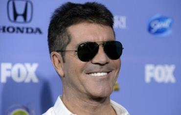 Simon Cowell attends the premiere of X Factor in West Hollywood, California September 5, 2013.