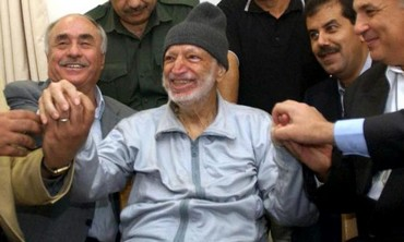 Former Palestinian Authority leader Yasser Arafat surrounded by doctors from Tunis, Egypt and Jordan