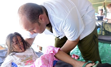 IDF Doctor with patient in the Philippines.