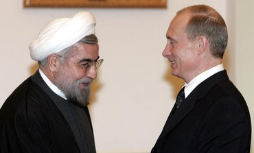 Iranian President Rouhani and Russian President Putin meet in Moscow, February 18, 2013.