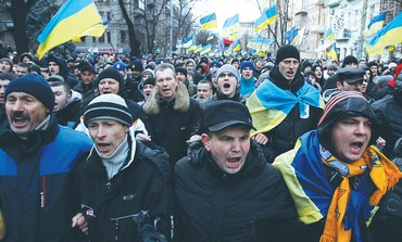 Protesters wave flags and shout slogans during a demonstration supporting EU integration in Kiev.