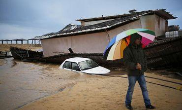 A man walks through flooded Kibbutz Nitzanim